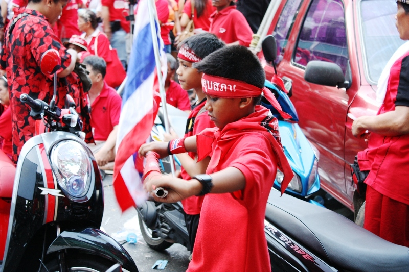 TWO THAI BOYS JOIN THE RED-SHIRT PROTESTS IN BANGKOK