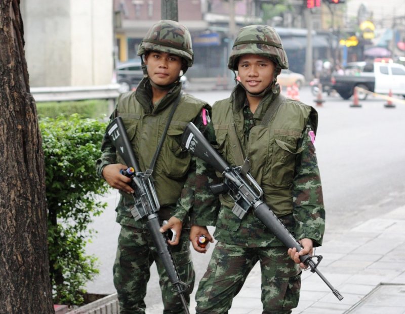 THAI SOLDIERS POSE FOR A PHOTO AT THE SOI NANA INTERSECTION